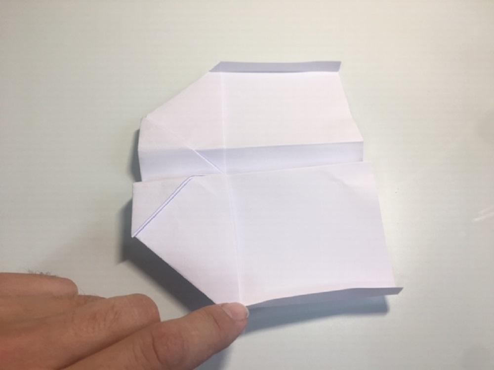 hacer una avión de papel